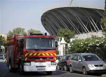 <p>A French fire brigade truck exists the Velodrome stadium in Marseille after a stage being constructed for a Madonna concert collapsed in the southern French city of Marseille killing one person and injuring six, July 16, 2009. REUTERS/Vincent Beaume</p>