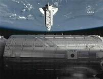 <p>The space shuttle Endeavour passes beneath the Japanese Kibo module of the International Space Station as it approaches the orbital outpost for docking in this image from NASA TV July 17, 2009. REUTERS/NASA TV</p>