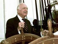 <p>Former CBS news anchor Walter Cronkite mans the helm on the USS Constitution for her historic voyage under sail, in this July 21, 1997 file photo. REUTERS/Terry A. Ironsides/U.S. Navy/Files</p>