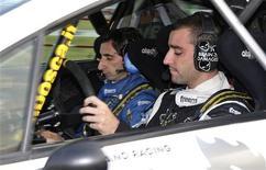 <p>Una immagine del pilota svizzero Brian Lavio e del navigatore italiano Flavio Guglielmini. REUTERS/Kurti Kurtev (BULGARIA SPORT MOTOR RACING)</p>