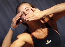 <p>Tania Cagnotto festeggia la medaglia di bronzo. REUTERS/Max Rossi (ITALY SPORT DIVING)</p>