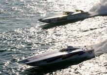 <p>Two powerboats speed across the water in a file photo. REUTERS/Ahmed Jadallah</p>