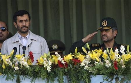 Mohammad Ali Jafari, new commander of Iran's Revolutionary Guards, salutes next to President Mahmoud Ahmadinejad during a ceremony to commemorate the 1980-88 Iran-Iraq war in Tehran September 22, 2007. REUTERS/Morteza Nikoubazl