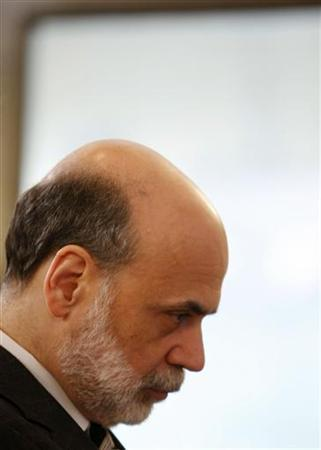Chairman of the Federal Reserve Ben Bernanke pauses while speaking at the Bureau of Labor Statistics 125th Anniversary celebration in Washington June 26, 2009. REUTERS/Larry Downing