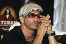 <p>Boxer Arturo Gatti listens at a news conference in Hoboken, New Jersey July 19, 2006. REUTERS/Teddy Blackburn</p>