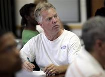 <p>Unemployed medical engineer Jim Lynch, 49, listens during an orientation meeting at the Michigan Works office in Lansing, Michigan, July 22, 2009. REUTERS/Rebecca Cook</p>