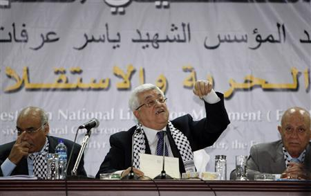 Palestinian President Mahmoud Abbas (C) speaks during the Fatah conference in the West Bank town of Bethlehem August 4, 2009. Abbas opened his Fatah movement's first conference in 20 years on Tuesday, saying Palestinians sought peace with Israel but ''resistance'' would stay an option. REUTERS/Nayef Hashlamoun (WEST BANK POLITICS)