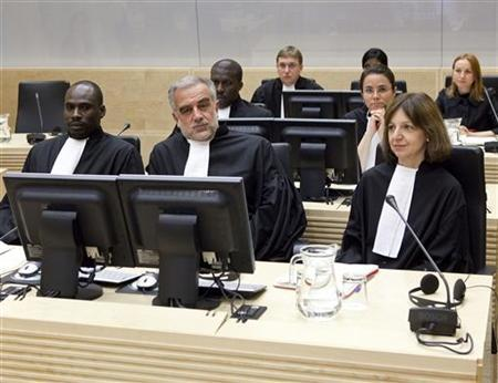 Prosecutor Luis Moreno-Ocampo (C) and his team are seated for the court appearance of Darfur rebel leader Bahr Idriss Abu Garda, at the International Criminal Court in The Hague May 18, 2009. REUTERS/Phil Nijhuis/Pool