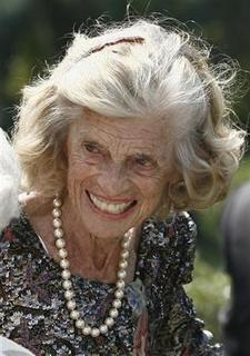 Honorary chairperson of the Special Olympics, Eunice Kennedy Shriver, smiles during a Special Olympics global law enforcement torch run ceremony in the Rose Garden of the White House in Washington, July 26, 2007. REUTERS/Jason Reed