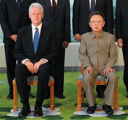 Former U.S. president Bill Clinton (seated L) and North Korea's leader Kim Jong-il (seated R) pose for a picture in Pyongyang in this photo released by North Korean official news agency KCNA August 4, 2009. North Korea has signaled it wants to improve relations with the United States and has been told it must return to nuclear disarmament talks, U.S. national security adviser Jim Jones said on Sunday. REUTERS/KCNA