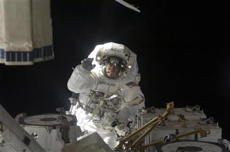 Astronaut Christopher Cassidy, STS-127 mission specialist, participates in the mission's fifth and final session of extravehicular activity (EVA) as construction and maintenance continue on the International Space Station in this NASA handout photo taken July 27, 2009. REUTERS/NASA/Handout