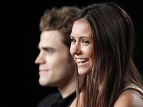 "<p>Actors Paul Wesley (L) and Nina Dobrev, co-stars of the new series ""The Vampire Diaries"", participate in a panel discussion at the CW Television Network Summer 2009 Television Critics Association press tour in Pasadena, California August 4, 2009.The 100-year-old horror genre is finding a new audience among angst-ridden teen girls with romance on their minds and as a result vampires are changing into kinder, gentler creatures who have sometimes curbed their appetite for fresh, young blood. Picture taken August 4, 2009. REUTERS/Danny Moloshok</p>"