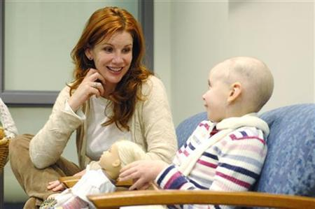Actress Melissa Gilbert visits with 10-year-old cancer sufferer Olivia Ward at Akron Children's Hospital in Akron, Ohio in this October 14, 2007 file photo. REUTERS/Akron Children's Hospital/Handout/Files