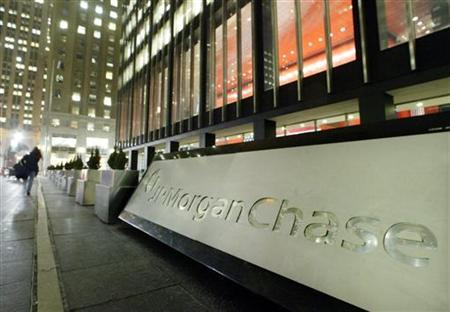 Pedestrians walk past J.P. Morgan Chase & Co. headquarters in New York, late January 14, 2004. REUTERS/Peter Morgan PM/HB