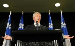 <p>Bloc Quebecois leader Gilles Duceppe gestures during a news conference in Montreal October 15, 2008. REUTERS/Mathieu Belanger (CANADA)</p>