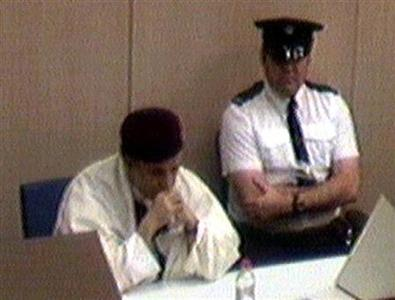 Libyan Abdel Basset al-Megrahi, who was sentenced to life in January 2001 for blowing up a New York-bound airliner and killing 270 passengers, crew and residents of the Scottish town of Lockerbie, sits during an appeal hearing at Camp Zeist, the Netherlands, in this file photo from March 14, 2002. REUTERS/Reuters TV KM