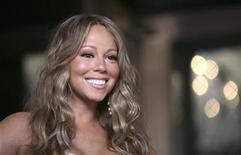 """<p>Singer Mariah Carey smiles on the set of her new music video """"Obsessed"""" outside New York's Plaza Hotel in New York June 29, 2009. REUTERS/Allison Joyce</p>"""