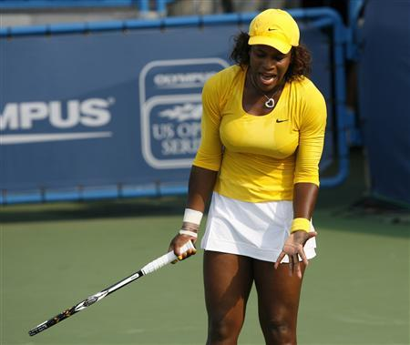 Serena Williams of the U.S. reacts after after missing her shot against Sybille Bammer of Austria during their third round match of the 2009 Cincinnati Women's Open tennis tournament in Cincinnati, August 13, 2009. REUTERS/John Sommers II