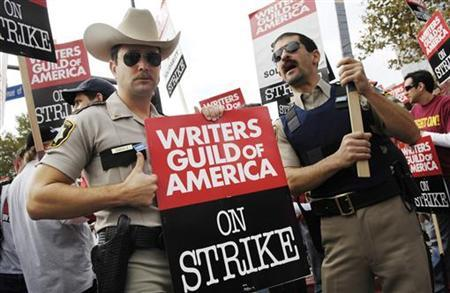 Writers Guild of America members Tom Lennon (L) and Robert Garant, cast members on the television show ''Reno 911'', participate in a large strike outside the Fox studio in Los Angeles November 9, 2007. Comedy Central has canceled the mocumentary series after six seasons. REUTERS/Chris Pizzello