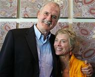 <p>In this file photo John Cleese (L) and his then wife Alyce Faye stand in front of an Aboriginal mural after a promotional news conference at Taronga Zoo in Sydney January 6, 2006. REUTERS/Will Burgess</p>