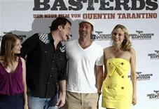 "<p>Director Quentin Tarantino and cast members Melanie Laurent, Brad Pitt and Diane Kruger pose during a photocall to promote ""Inglourious Basterds"" in Berlin, July 28, 2009. REUTERS/Fabrizio Bensch</p>"