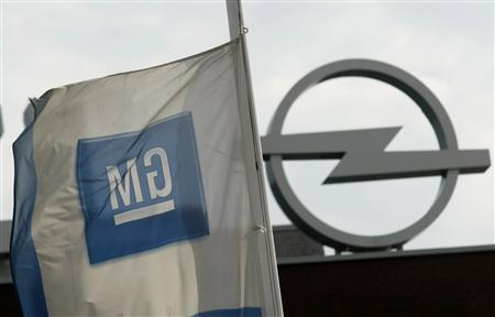 A flag of GM (General Motors) is seen next to an Opel logo at the Opel plant in Bochum August 25, 2009. REUTERS/Ina Fassbender