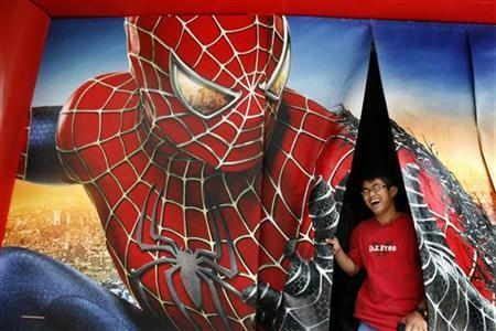 A man laughs after watching a ''Spider-Man 3'' promotional video in Hong Kong May 2, 2007. REUTERS/Claro Cortes IV