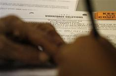 <p>A person fills out an application for a summer job funded by stimulus money in Forth Worth, Texas June 10, 2009. REUTERS/Jessica Rinaldi</p>