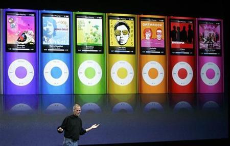 Apple Inc CEO Steve Jobs speaks as colorful redesigned iPod Nano are displayed at Apple's ''Let's Rock'' media event in San Francisco, California September 9, 2008. REUTERS/Robert Galbraith