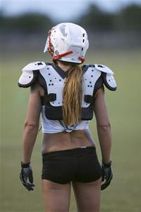 Miami Caliente's Safety Sarah Kimball waits for a play to begin during practice for the Lingerie Football League in Davie, Florida, August 27, 2009. REUTERS/Andrew Innerarity