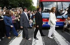 "<p>Members of The Beatles tribute band Sgt Pepper's Only Dart Board Band recreate the iconic ""Abbey Road"" album cover photograph on its 40th anniversary in London, August 8, 2009. REUTERS/Luke MacGregor</p>"