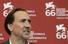 <p>U.S. actor Nicolas Cage poses for photographers during a photocall at the 66th Venice Film Festival September 4, 2009. REUTERS/Tony Gentile</p>