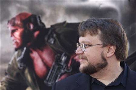 Director Guillermo del Toro poses for photographers during the premiere of the movie ''Hellboy II The Golden Army'' in Los Angeles, California, June 28, 2008. The Hollywood studio behind a film based on ''The Hobbit'' and trustees for author J.R.R. Tolkien's estate said on Tuesday they had settled a lawsuit that clears the way for what is expected to be a blockbuster movie based on the book. The book will be made into two movies by del Toro. REUTERS/Hector Mata