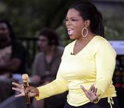 <p>Oprah Winfrey reacts to the crowd as she starts a taping celebrating the 24th season of The Oprah Winfrey Show in Chicago September 8, 2009. REUTERS/Frank Polich</p>