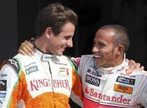<p>Lewis Hamilton e Adrian Sutil. REUTERS/Stefano Rellandini</p>