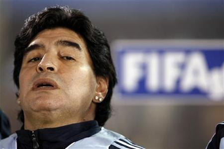 Argentina's coach Diego Maradona reacts during their World Cup 2010 qualifying match against Paraguay in Asuncion September 9, 2009. REUTERS/Marcos Brindicci