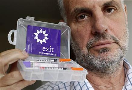 Euthanasia campaigner Dr. Philip Nitschke poses with his 'suicide kit' after a Reuters interview in London in this May 7, 2009 file photo. It used to be an issue just for the terminally ill. Now as populations around the world age, governments are increasingly being confronted with the taboo idea of dying as something people can volunteer to do. Nitschke, founder and director of the pro-euthanasia group Exit International, -- nicknamed Dr Death for his work on suicide -- is travelling the world to teach people how to end their lives safely with a suicide drug-testing kit. REUTERS/Stefan Wermuth/Files