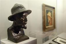 <p>A bronze bust of French impressionist artist Auguste Renoir is seen next to an self-portrait during a media preview at the Grand Palais in Paris September 21, 2009. REUTERS/Gareth Watkins</p>