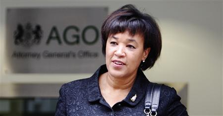Attorney General Patricia Scotland leaves her office in central London September 22, 2009. REUTERS/Luke MacGregor