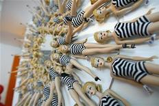 <p>A wall mirror, by interior designer Jonathan Adler, realized using 65 reproduction dolls of the original 1959 Black and White Bathing Suit model, is pictured at a Barbie's 50th birthday party at the Barbie's real-life Malibu Dream House in Malibu, California March 9, 2009. REUTERS/Mario Anzuoni</p>