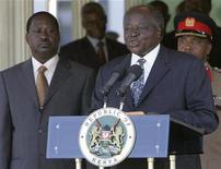 <p>Kenya's President Mwai Kibaki (R) address the media during the announcement of his cabinet as Prime Minister Raila Odinga looks on at state House Nairobi April 13, 2008. REUTERS/Antony Njuguna</p>