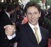 <p>Belgian singer Helmut Lotti points to photographers as he arrives at the Plaza hotel ahead of the Platinum Europe Music Awards ceremony in Brussels in this July 13, 2000 file photo. REUTERS/Yves Herman/Files</p>