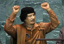 <p>Libyan leader Muammar Gaddafi gestures at the end of his address to the 64th United Nations General Assembly at the U.N. headquarters in New York, September 23, 2009. Gaddafi, in his first ever address to the United Nations, on Wednesday accused the veto-wielding powers of the Security Council of betraying the principles of the U.N. charter. REUTERS/Mike Segar</p>