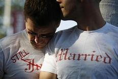 <p>Gay couple Ethan Collings (L), 32, and his spouse Stephen Abate, 36, hug as they celebrate their one-year wedding anniversary in West Hollywood, California, June 16, 2009. REUTERS/Lucy Nicholson</p>