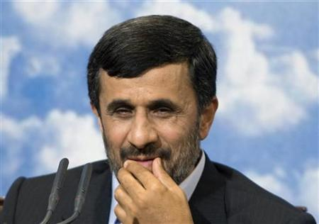 Iranian President Mahmoud Ahmadinejad touches his lips as he speaks at a news conference in Tehran May 25, 2009. REUTERS/Raheb Homavandi