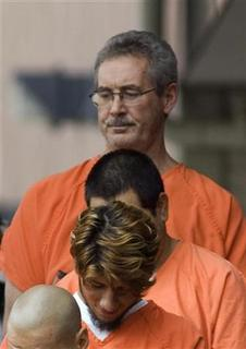 Allen Stanford (top) the former billionaire accused of a $7 billion fraud, leaves federal court in Houston in this September 15, 2009 file photo. REUTERS/Richard Carson