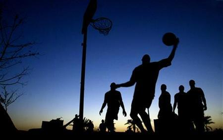 U.S. soldiers of the Fourth Infantry Division play basketball at a U.S. army base in Tikrit, about 110 miles (180 kilometers) northwest of Baghdad September 11, 2003. REUTERS/Arko Datta
