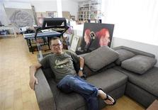 <p>Indonesian artist Agus Suwage poses in his studio in Yogyakarta, Central Java September 28, 2009. Suwage knows what it is like to run up against the religious conservatives. Four years ago, he was hauled into parliament, where lawmakers accused him of blasphemy and of producing pornography dressed up as art. Today, facing an even more restrictive climate in Indonesia, Suwage refuses to be silenced and has made those restrictions the focus of his art. Picture taken September 28, 2009. REUTERS/Stringer</p>