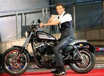"<p>Actor Hugh Jackman poses on a Harley Davidson to fans before riding it at a red carpet event for the Japan premiere of ""X-men Origins: Wolverine"" in Tokyo, September 3, 2009. REUTERS/Kim Kyung-Hoon</p>"