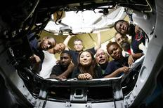 <p>West Philly Hybrid X team members look into the power plant compartment a Ford Focus which is under conversion for the Automotive X-Prize competition at the team facility in Philadelphia, Pennsylvania, September 24, 2009. REUTERS/Tim Shaffer</p>